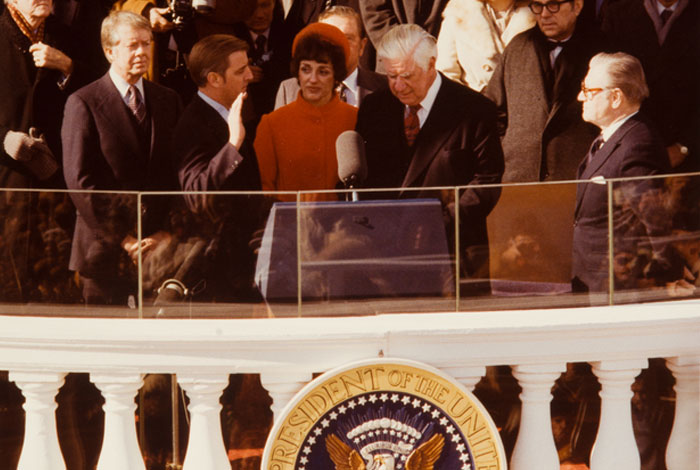 Speaker of the House Tip O'Neill administers the vice presidential oath of office to Walter Mondale as Hubert Humphrey, Jimmy Carter, Joan Mondale and others look on.