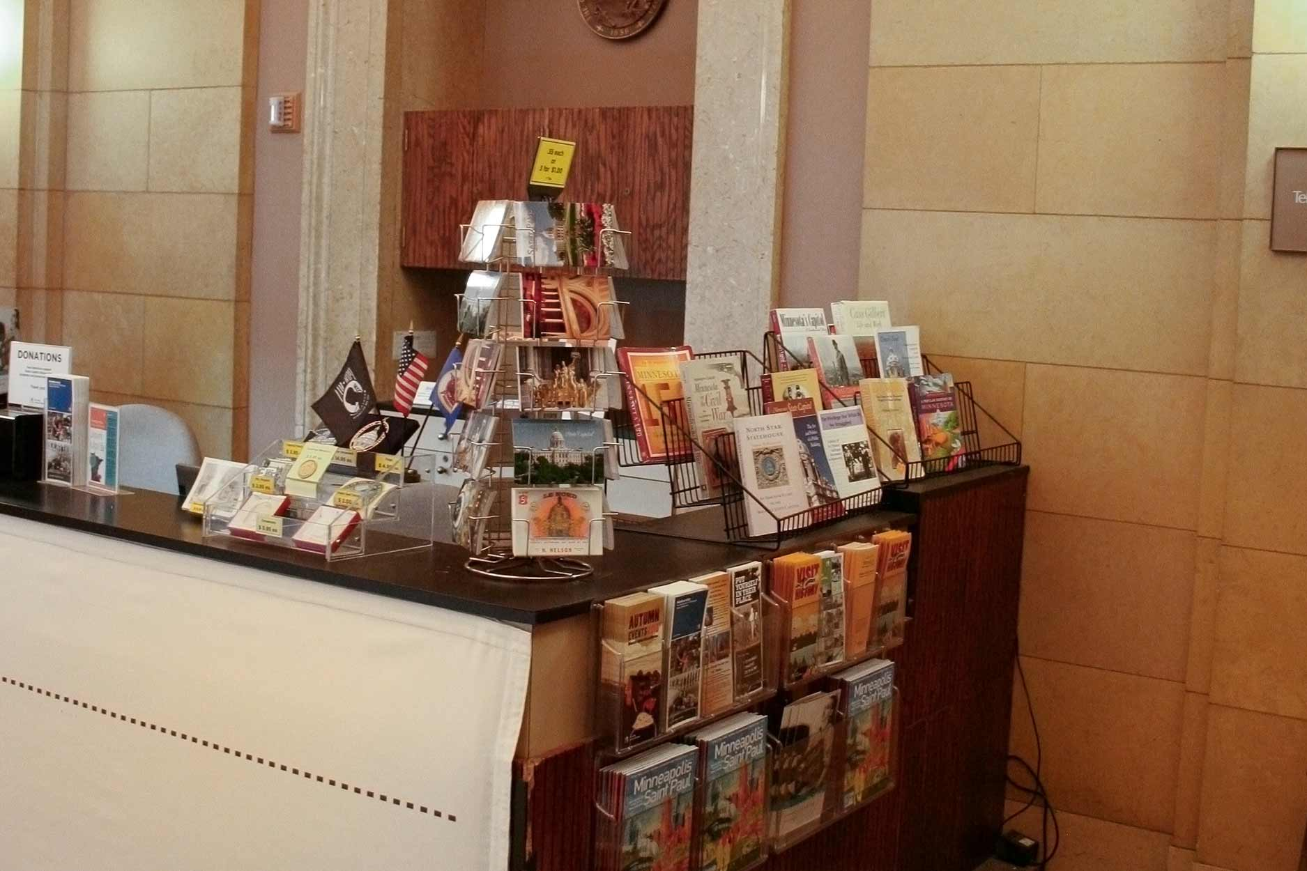 The State Capitol front desk, with postcards and brochures