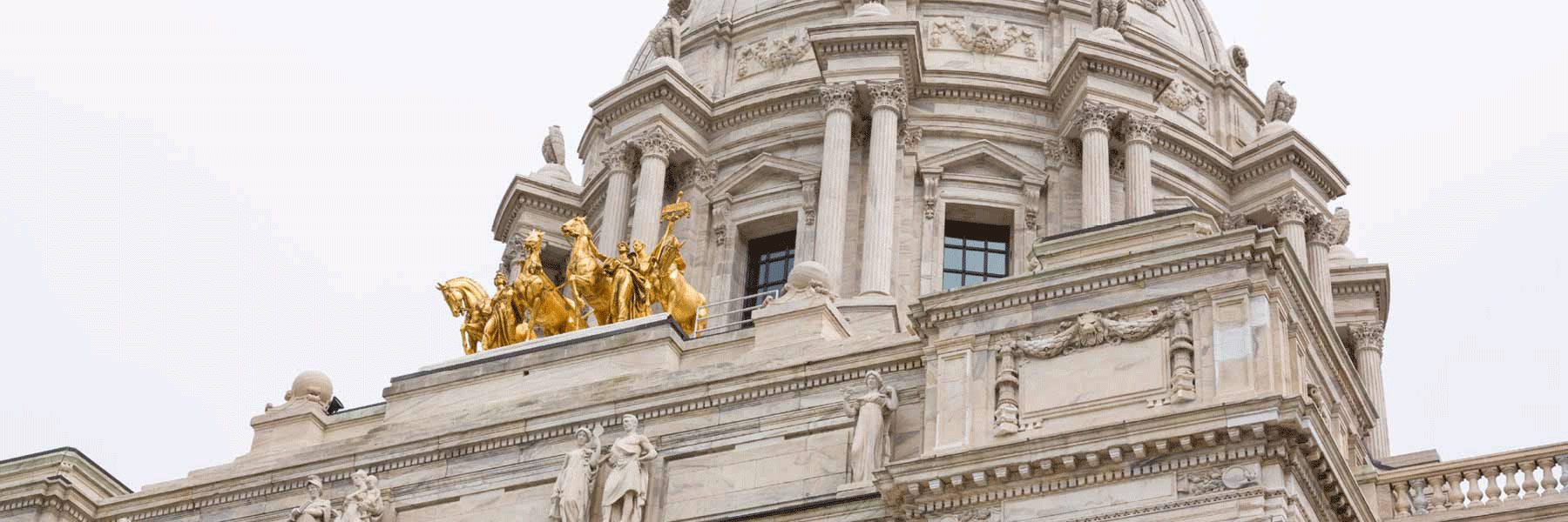 Minnesota State Capitol dome and Quadriga golden sculpture.