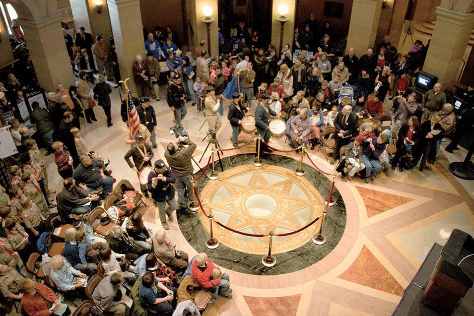 A group of people sitting in chairs in the rotunda