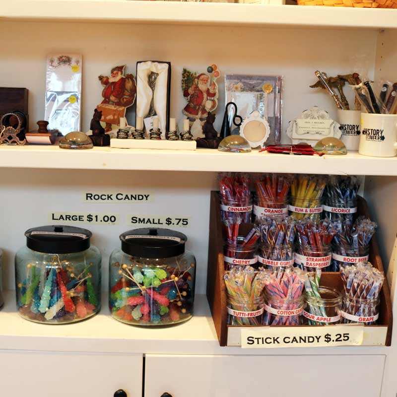 Shelves holding items for sale in the gift shop: rock candy and bookmarks.