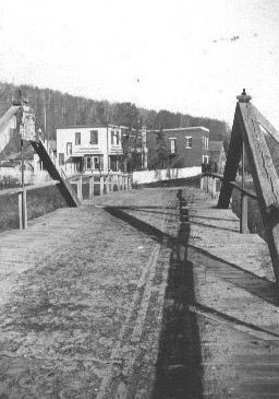 The second of three bridges spanning the south branch of the Root River upon entering Forestville.