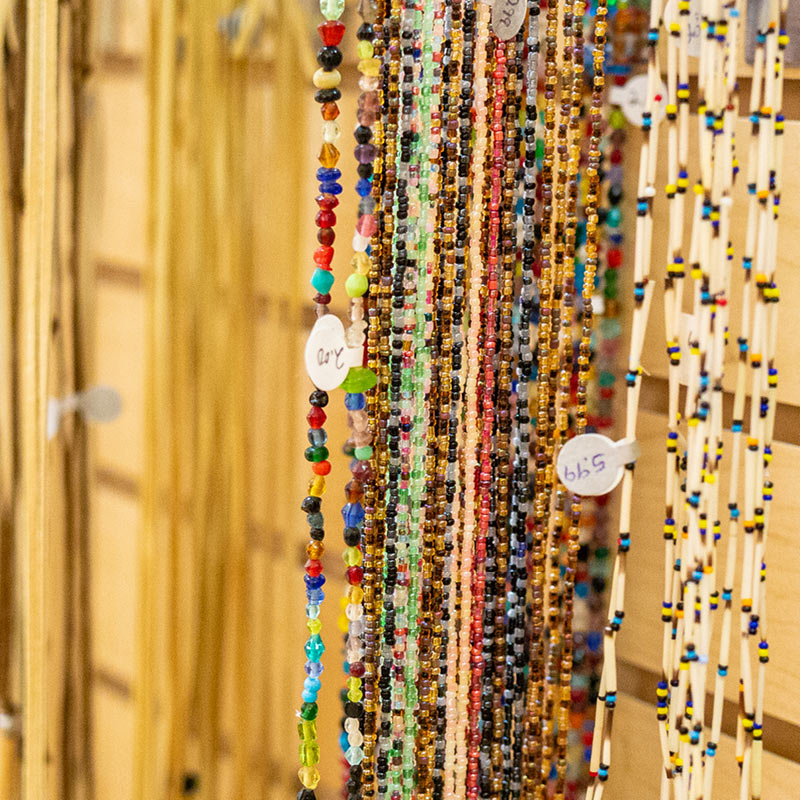 A display of glass bead necklaces.