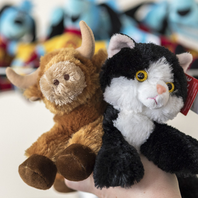 Stuffed animals - ox and black-and-white cat