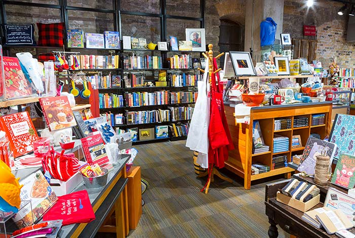 Displays of items for purchase in the museum store: aprons, books, stationery, and more.