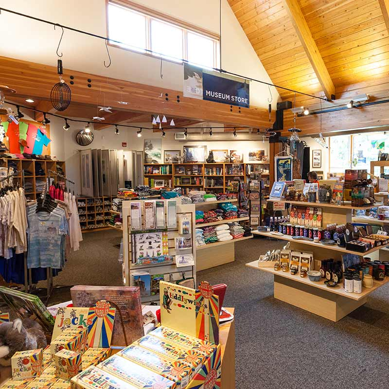 Racks of clothes and assorted items on shelves in the gift shop