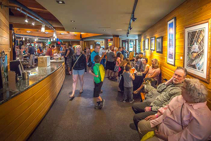 People sitting and walking through the visitor center