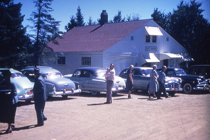 Tourists and cars outside the gift shop, 1951