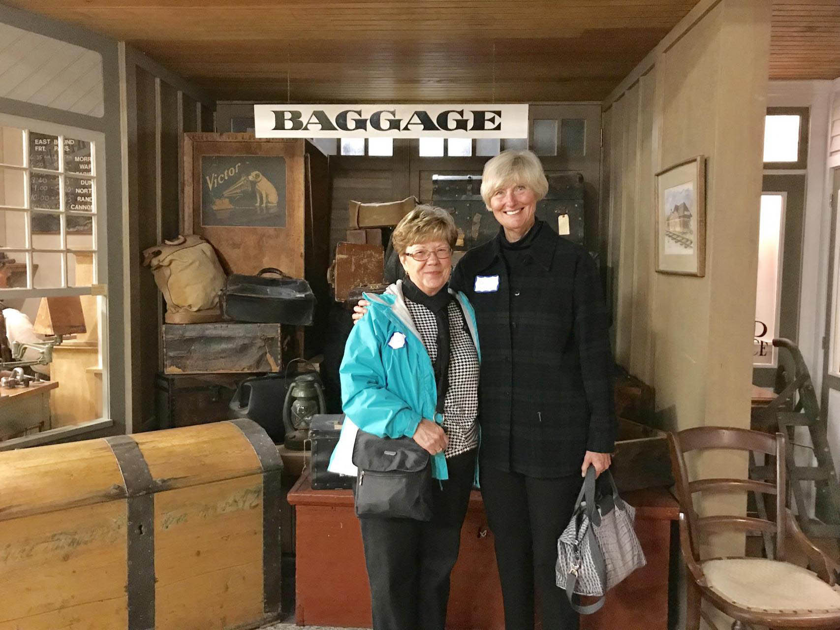 Two women at a historic train station.