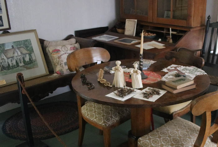 Table with historical artifacts and books.
