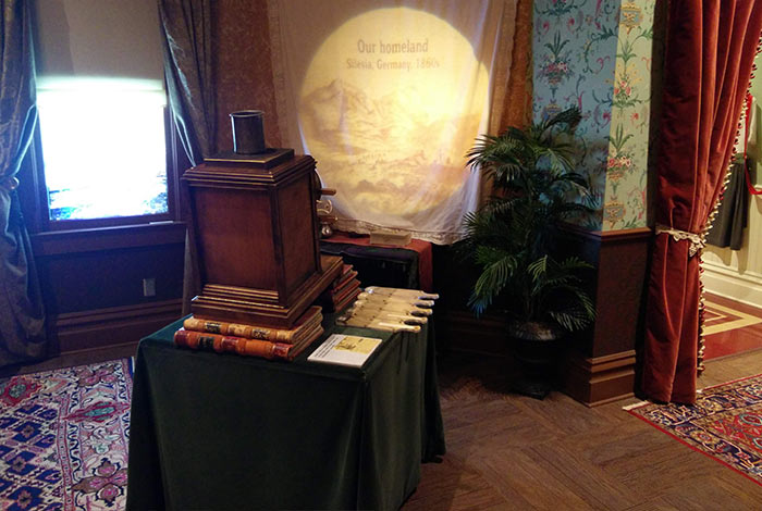 An antique projector sits propped up on books in the parlor.