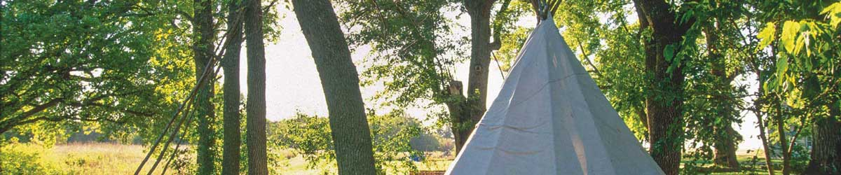 Lower Sioux Agency community tipi in morning sunlight.