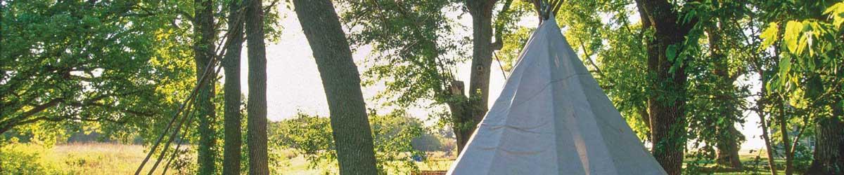 Lower Sioux Agency community tipi in morning sunlight.