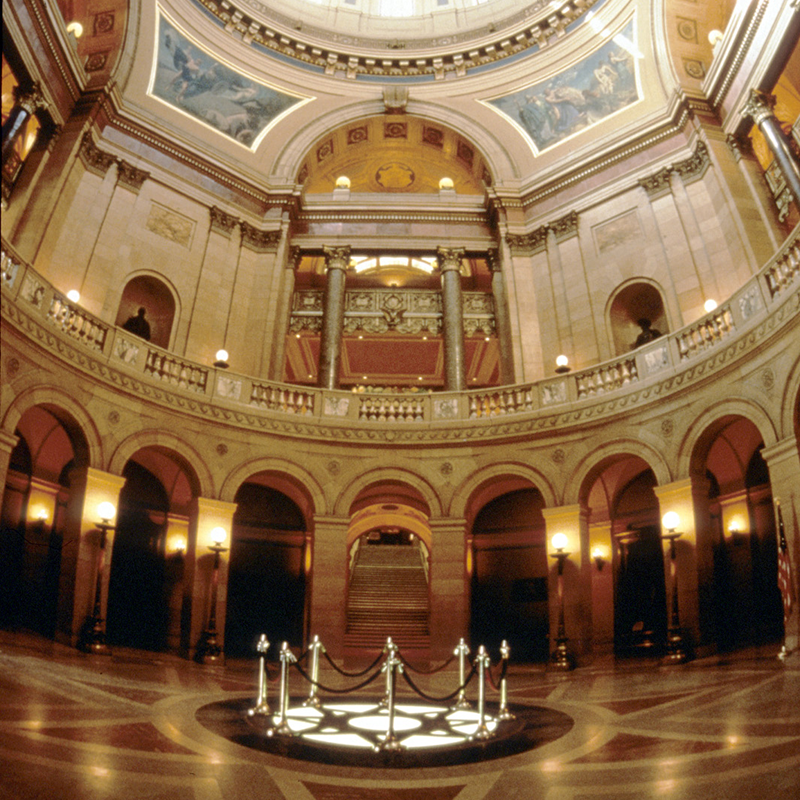 Close to the middle of the rotunda, near the floor, looking up almost to the base of the dome