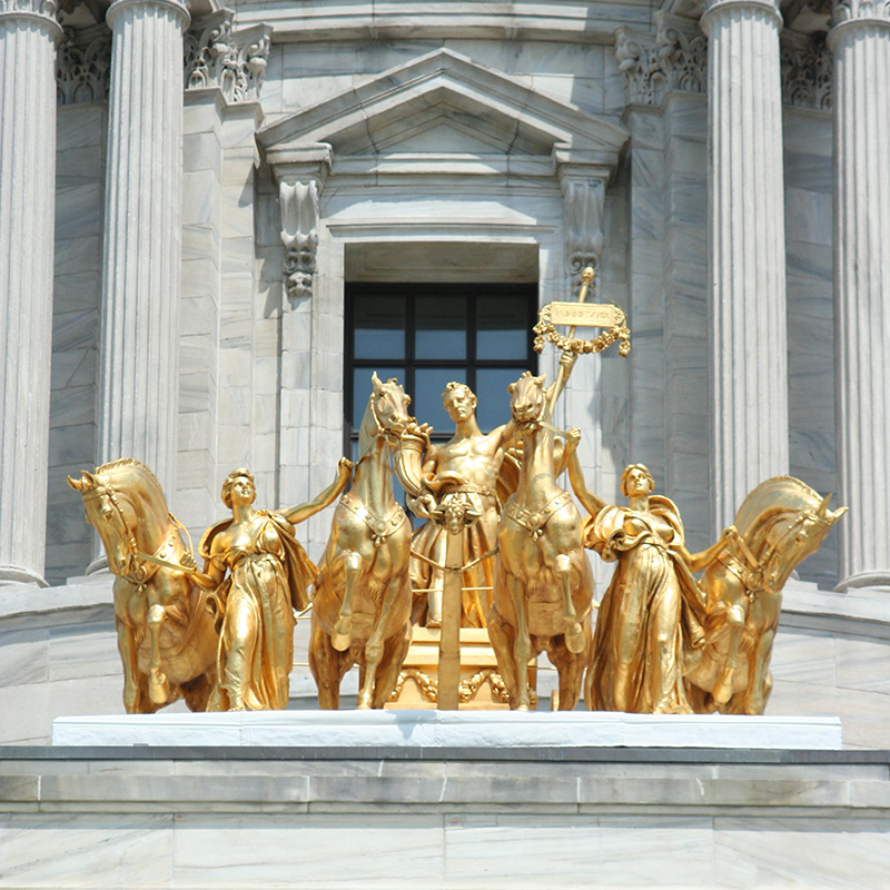 The golden Quadriga sculpture viewed from the front