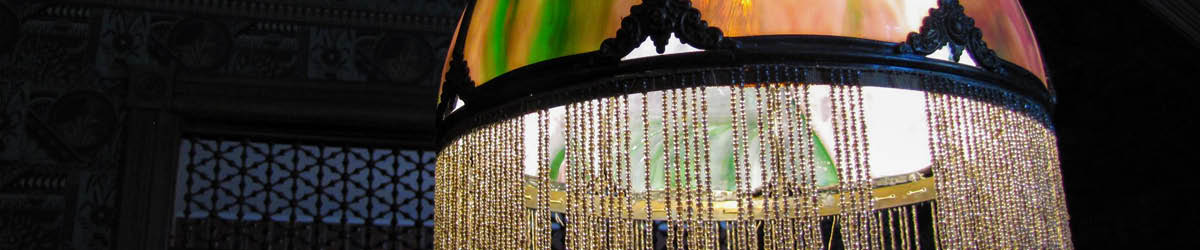 Close-up of a lighted classic stained glass table lamp.