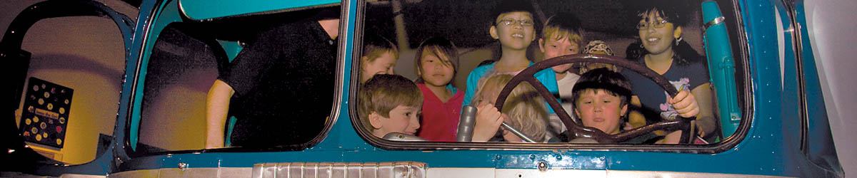 Children in a bus exhibit.