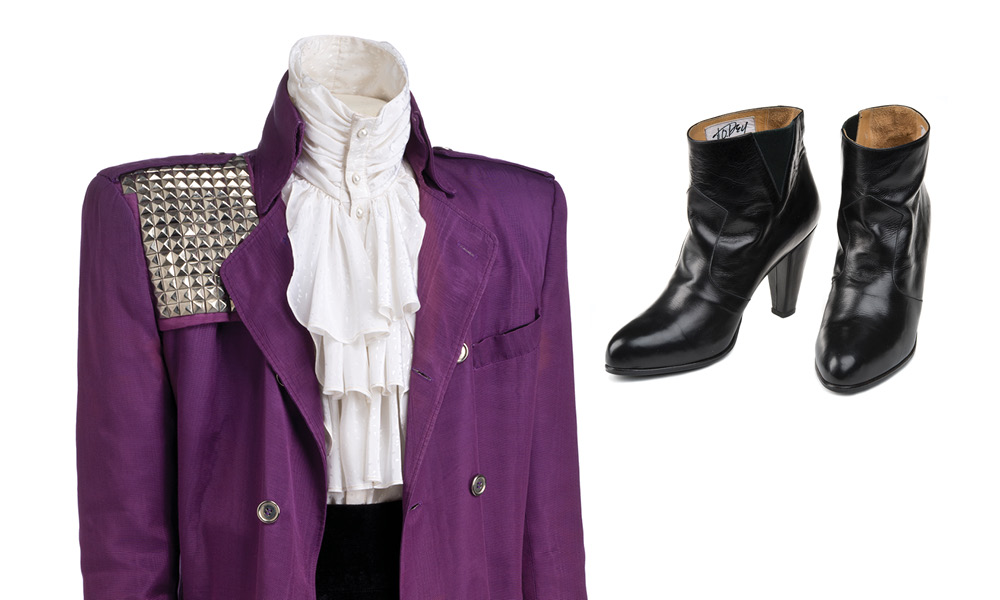"Detail of Prince's ""Purple Rain"" suit on the left with his high-heeled black leather boots on right."