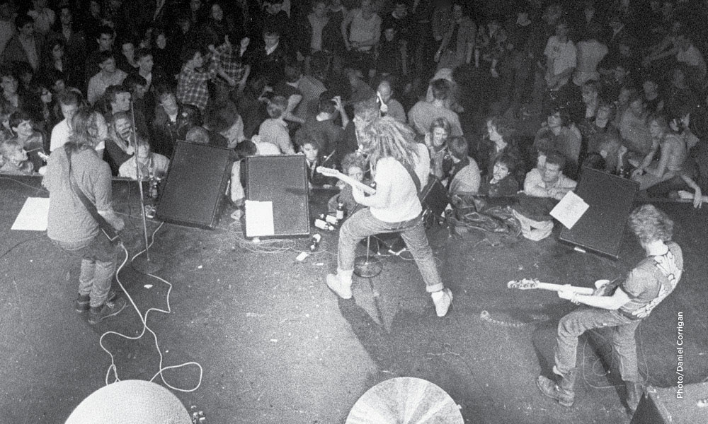 Bird's eye view of Soul Asylum performing on stage with fans in the background.