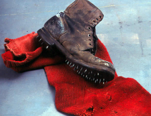 Color photo of a caulk boot and a large red sock with holes in it.