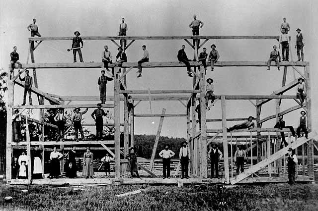 Photo of the lumber frame of a large barn from the Rainy River district, 1900.