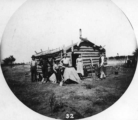 Photograph of a frontier cabin, 1880.