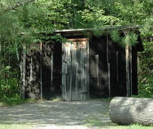 Color photo of an outhouse at the Forest History Center