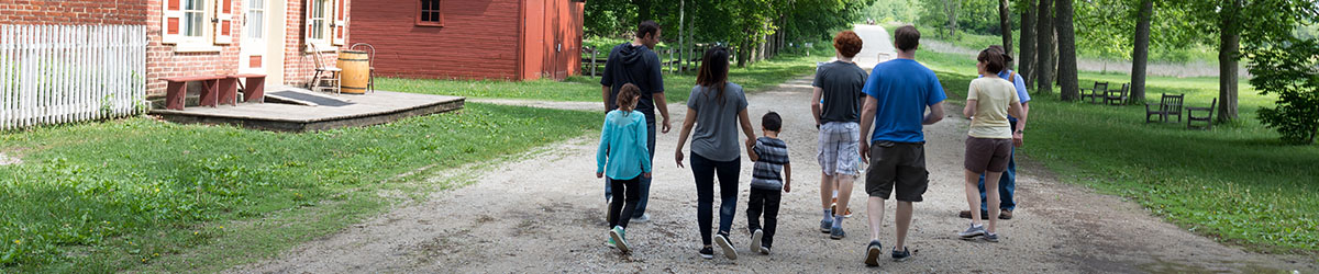 Visitors wander the road and around the buildings at Historic Forestville.