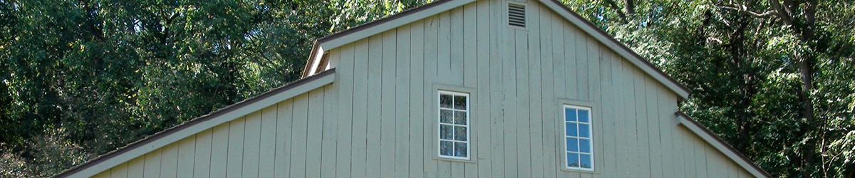 Exterior view of upper gable of Historic Forestville's visitor center.