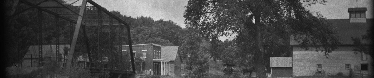 Historic photo of the structures and bridge in Forestville.