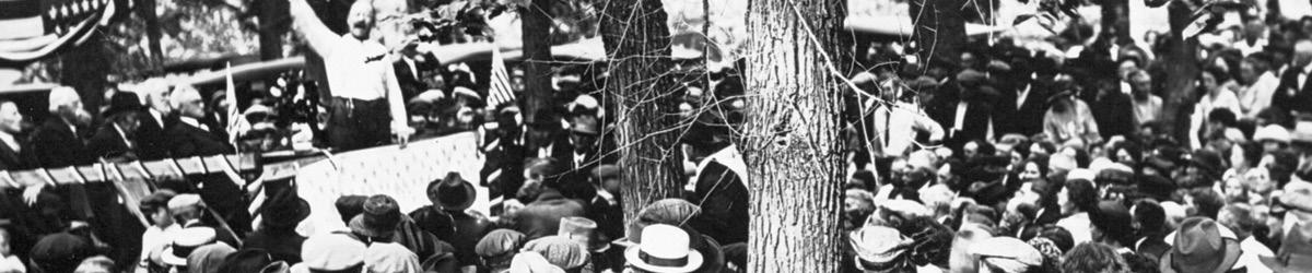 Senator Magnus Johnson on a platform speaking to a crowd in Forestville.