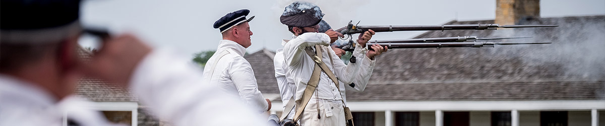 Interpreters in soldier uniform fire rifles.