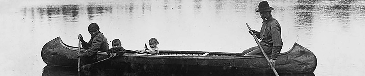 Unidentified Ojibwe family in canoe at Vermilion Lake, about 1905.