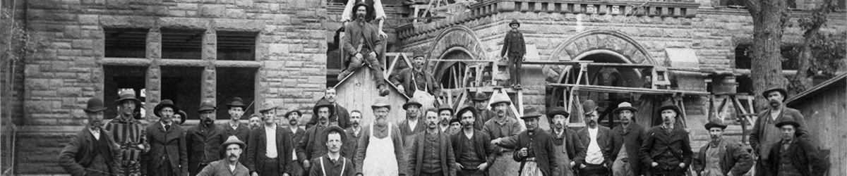 Construction crew posing in front of James J. Hill House