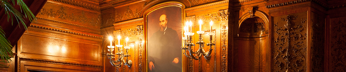 Portrait of James J. Hill between a pair of candelabras over an ornate fireplace