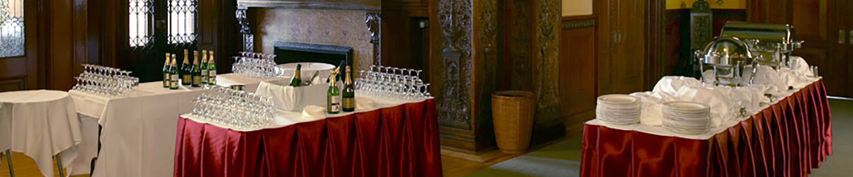Tables set up with glassware and barware for a rental