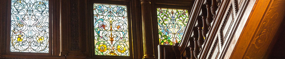 Three of the stained glass windows and part of the grand staircase