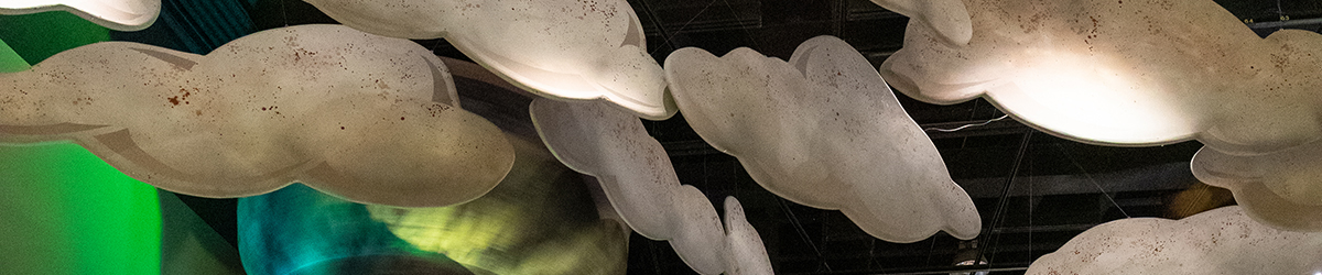 Clouds hanging in the Weather Permitting exhibit.