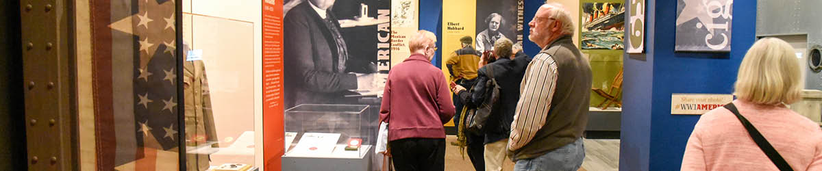 A group of adults walking through an exhibit.