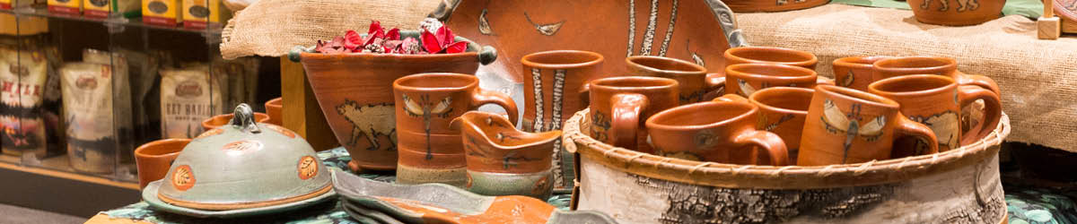 A collection of brown ceramic pottery on display in the Minnesota History Center shop.