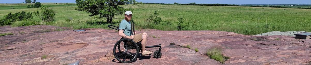 A man using a grit wheelchair at Jeffers petroglyphs.