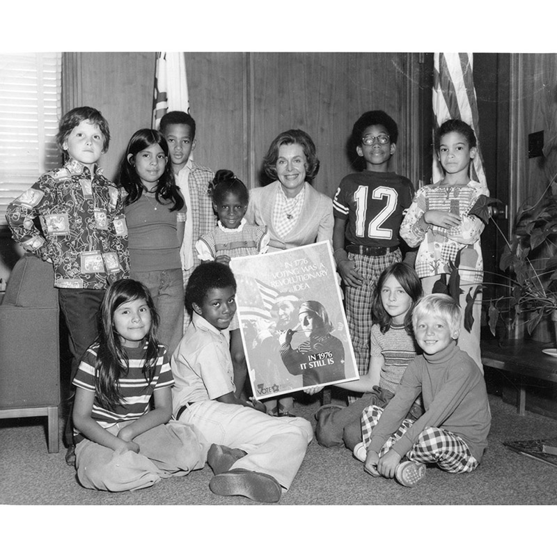 Joan Growe and kids encourage voting, 1976.