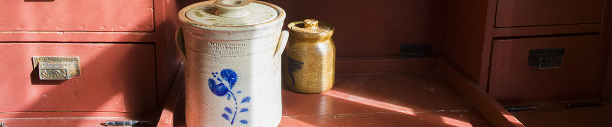 A small and a large crock on a table