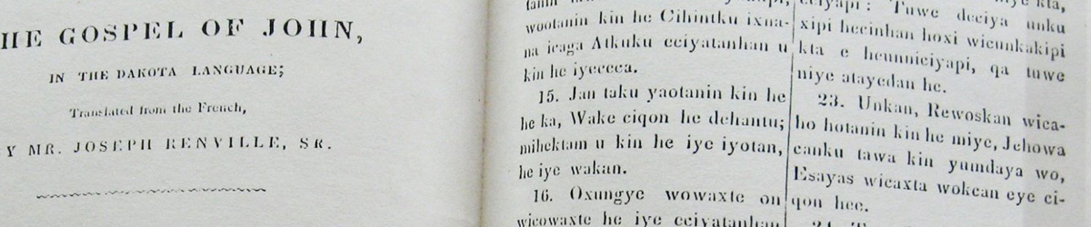 An open book titled The Gospel of John, in the Dakota Language.