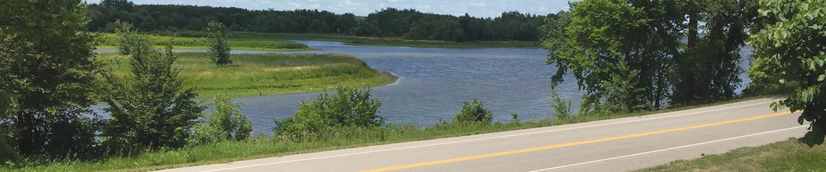 Minnesota River runs along 140th Ave NW quietly.