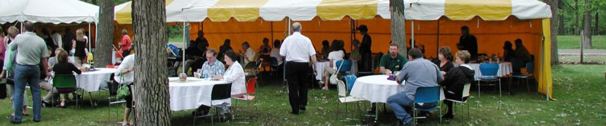People gathering at an outdoor event.