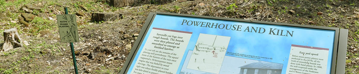 "Top half of a Marine Mill interpretive sign with the title ""Powerhouse and Kiln."""