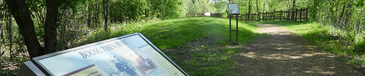 A path in a park with interpretive boards.
