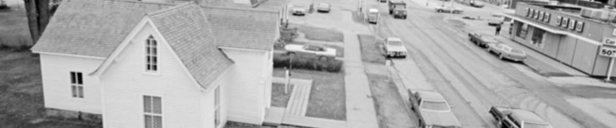 Birds' eye view of W. W. Mayo House with cars on the street in front of the house.