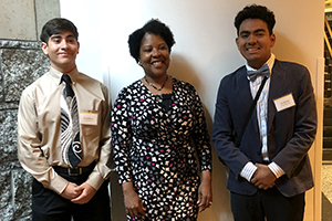 Scholarship winners Jonathan Rosario and Antonio Dominguez with Melanie Adams from MNHS